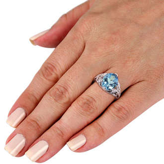 6ct Oval Blue Topaz and Diamond Ring Crafted In Solid 14K White Gold