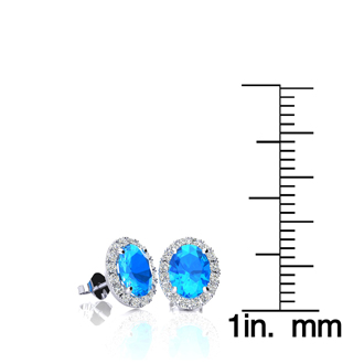 1 1/4 Carat Oval Shape Blue Topaz and Halo Diamond Stud Earrings In 10 Karat White Gold