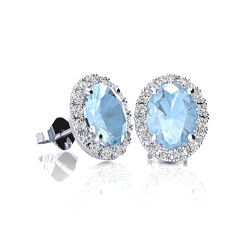 1 Carat Oval Shape Aquamarine and Halo Diamond Stud Earrings In 14 Karat White Gold