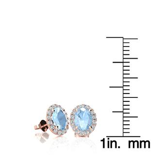 1 Carat Oval Shape Aquamarine and Halo Diamond Stud Earrings In 14 Karat Rose Gold