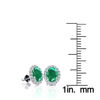 1 Carat Oval Shape Emerald and Halo Diamond Stud Earrings In 14 Karat White Gold