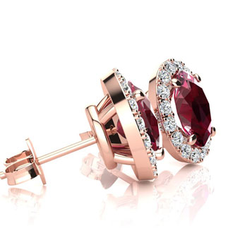 1 1/4 Carat Oval Shape Ruby and Halo Diamond Stud Earrings In 14 Karat Rose Gold