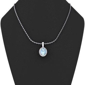 1 1/2 Carat Oval Shape Blue Topaz and Halo Diamond Necklace In 10 Karat White Gold With 18 Inch Chain