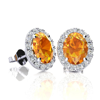 1 1/2 Carat Oval Shape Citrine and Halo Diamond Stud Earrings In 14 Karat White Gold