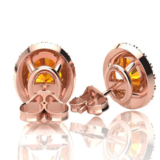 1 1/2 Carat Oval Shape Citrine and Halo Diamond Stud Earrings In 14 Karat Rose Gold