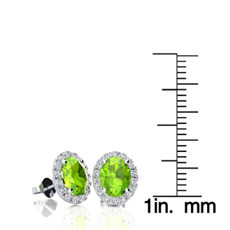 2 Carat Oval Shape Peridot and Halo Diamond Stud Earrings In 14 Karat White Gold