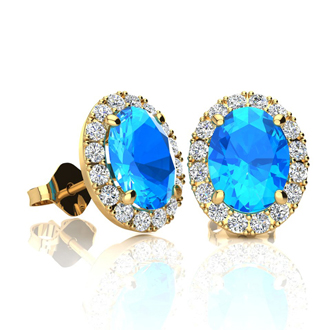 2 1/4 Carat Oval Shape Blue Topaz and Halo Diamond Stud Earrings In 14 Karat Yellow Gold
