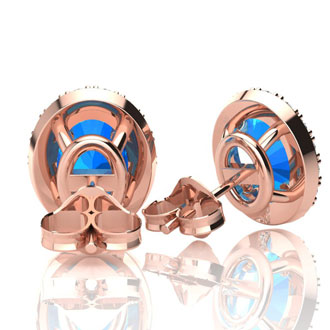 2 1/4 Carat Oval Shape Blue Topaz and Halo Diamond Stud Earrings In 10 Karat Rose Gold
