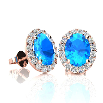2 1/4 Carat Oval Shape Blue Topaz and Halo Diamond Stud Earrings In 14 Karat Rose Gold