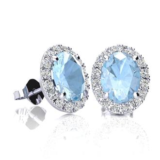 1 3/4 Carat Oval Shape Aquamarine and Halo Diamond Stud Earrings In 10 Karat White Gold