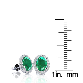 1 3/4 Carat Oval Shape Emerald and Halo Diamond Stud Earrings In 14 Karat White Gold