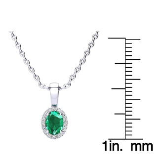 1/2 Carat Oval Shape Emerald and Halo Diamond Necklace In 10 Karat White Gold With 18 Inch Chain
