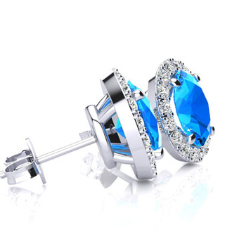 3 1/4 Carat Oval Shape Blue Topaz and Halo Diamond Stud Earrings In 10 Karat White Gold