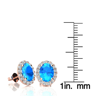 3 1/4 Carat Oval Shape Blue Topaz and Halo Diamond Stud Earrings In 10 Karat Rose Gold