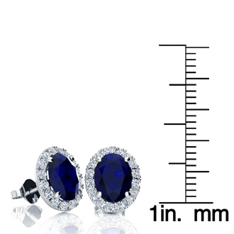 3 1/2 Carat Oval Shape Sapphire and Halo Diamond Stud Earrings In 10 Karat White Gold