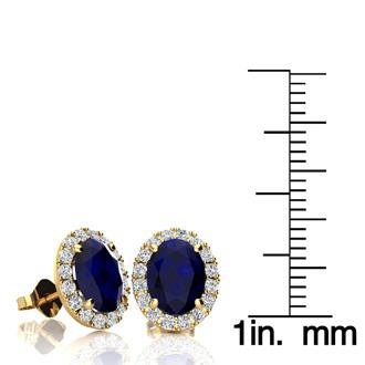 3 1/2 Carat Oval Shape Sapphire and Halo Diamond Stud Earrings In 10 Karat Yellow Gold