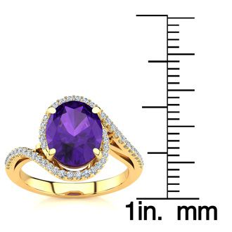 2 1/2 Carat Oval Shape Amethyst and Halo Diamond Ring In 14 Karat Yellow Gold
