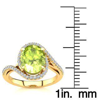 2 3/4 Carat Oval Shape Peridot and Halo Diamond Ring In 14 Karat Yellow Gold