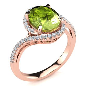2 3/4 Carat Oval Shape Peridot and Halo Diamond Ring In 14 Karat Rose Gold