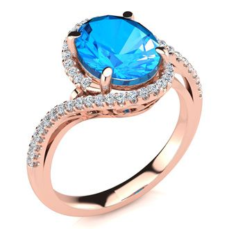 3 1/2 Carat Oval Shape Blue Topaz and Halo Diamond Ring In 14 Karat Rose Gold