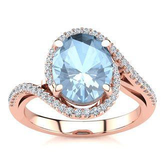 2 1/2 Carat Oval Shape Aquamarine and Halo Diamond Ring In 14 Karat Rose Gold