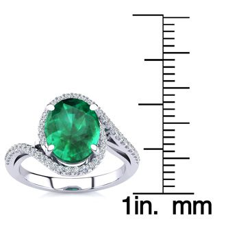 2 1/2 Carat Oval Shape Emerald and Halo Diamond Ring In 14 Karat White Gold
