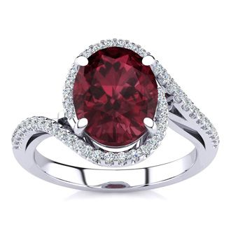 3 1/3 Carat Oval Shape Garnet and Halo Diamond Ring In 14 Karat White Gold