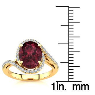 3 1/3 Carat Oval Shape Garnet and Halo Diamond Ring In 14 Karat Yellow Gold