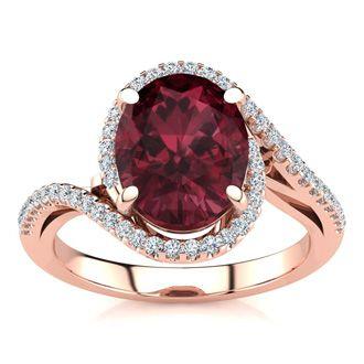 3 1/3 Carat Oval Shape Garnet and Halo Diamond Ring In 14 Karat Rose Gold