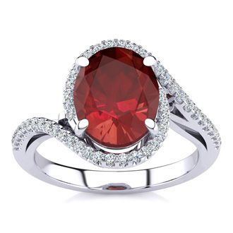 3 1/3 Carat Oval Shape Ruby and Halo Diamond Ring In 14 Karat White Gold