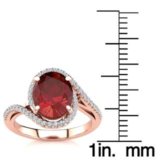 3 1/3 Carat Oval Shape Ruby and Halo Diamond Ring In 14 Karat Rose Gold