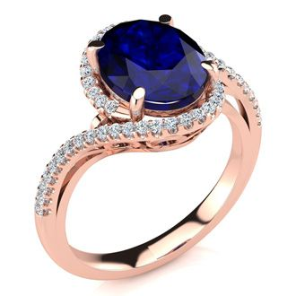 3 1/3 Carat Oval Shape Sapphire and Halo Diamond Ring In 14 Karat Rose Gold