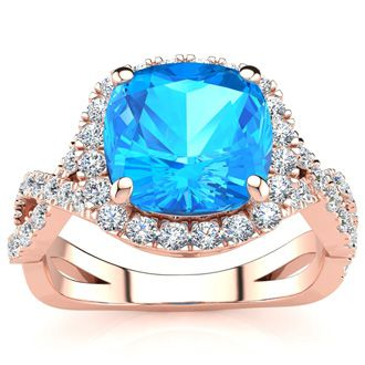 3 Carat Cushion Cut Blue Topaz and Halo Diamond Ring With Fancy Band In 14 Karat Rose Gold