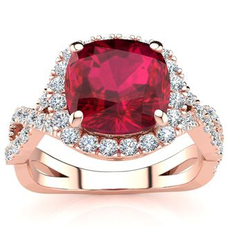 3 1/2 Carat Cushion Cut Ruby and Halo Diamond Ring With Fancy Band In 14 Karat Rose Gold