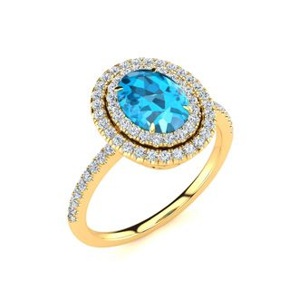 1 3/4 Carat Oval Shape Blue Topaz and Double Halo Diamond Ring In 14 Karat Yellow Gold