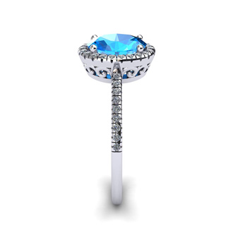 1 3/4 Carat Oval Shape Blue Topaz and Halo Diamond Ring In 14 Karat White Gold