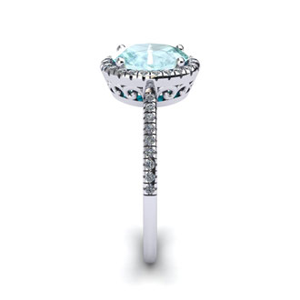 1 1/3 Carat Oval Shape Aquamarine and Halo Diamond Ring In 14 Karat White Gold