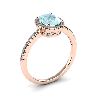 1 1/3 Carat Oval Shape Aquamarine and Halo Diamond Ring In 14 Karat Rose Gold