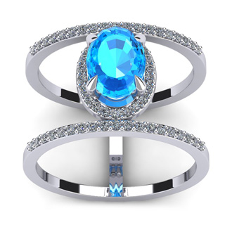 1 3/4 Carat Oval Shape Blue Topaz and Halo Diamond Spacer Ring In 14 Karat White Gold
