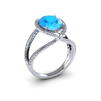 3 3/4 Carat Oval Shape Blue Topaz and Halo Diamond Ring In 14 Karat White Gold
