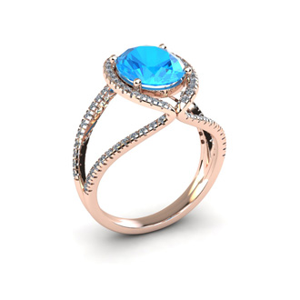 3 3/4 Carat Oval Shape Blue Topaz and Halo Diamond Ring In 14 Karat Rose Gold