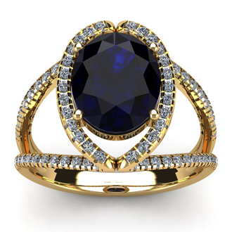 3 1/2 Carat Oval Shape Sapphire and Halo Diamond Ring In 14 Karat Yellow Gold