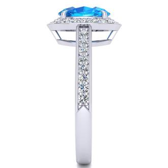 1 3/4 Carat Oval Shape Blue Topaz and Halo Diamond Ring In 14 Karat White Gold