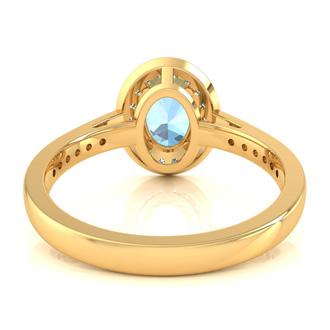1 1/2 Carat Oval Shape Aquamarine and Halo Diamond Ring In 14 Karat Yellow Gold