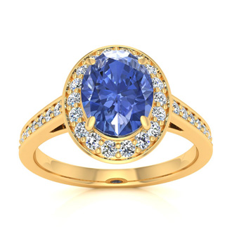 1 1/2 Carat Oval Shape Tanzanite and Halo Diamond Ring In 14 Karat Yellow Gold