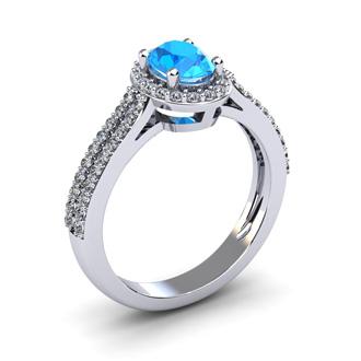 1 1/2 Carat Oval Shape Blue Topaz and Halo Diamond Ring In 14 Karat White Gold