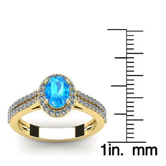 1 1/2 Carat Oval Shape Blue Topaz and Halo Diamond Ring In 14 Karat Yellow Gold