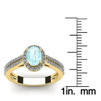 1 1/4 Carat Oval Shape Aquamarine and Halo Diamond Ring In 14 Karat Yellow Gold