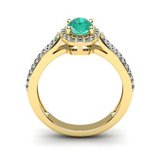 1 1/4 Carat Oval Shape Emerald and Halo Diamond Ring In 14 Karat Yellow Gold