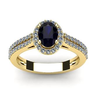 1 1/2 Carat Oval Shape Sapphire and Halo Diamond Ring In 14 Karat Yellow Gold
